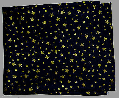 cotton fat quarter with small gold stars on dark navy blue background
