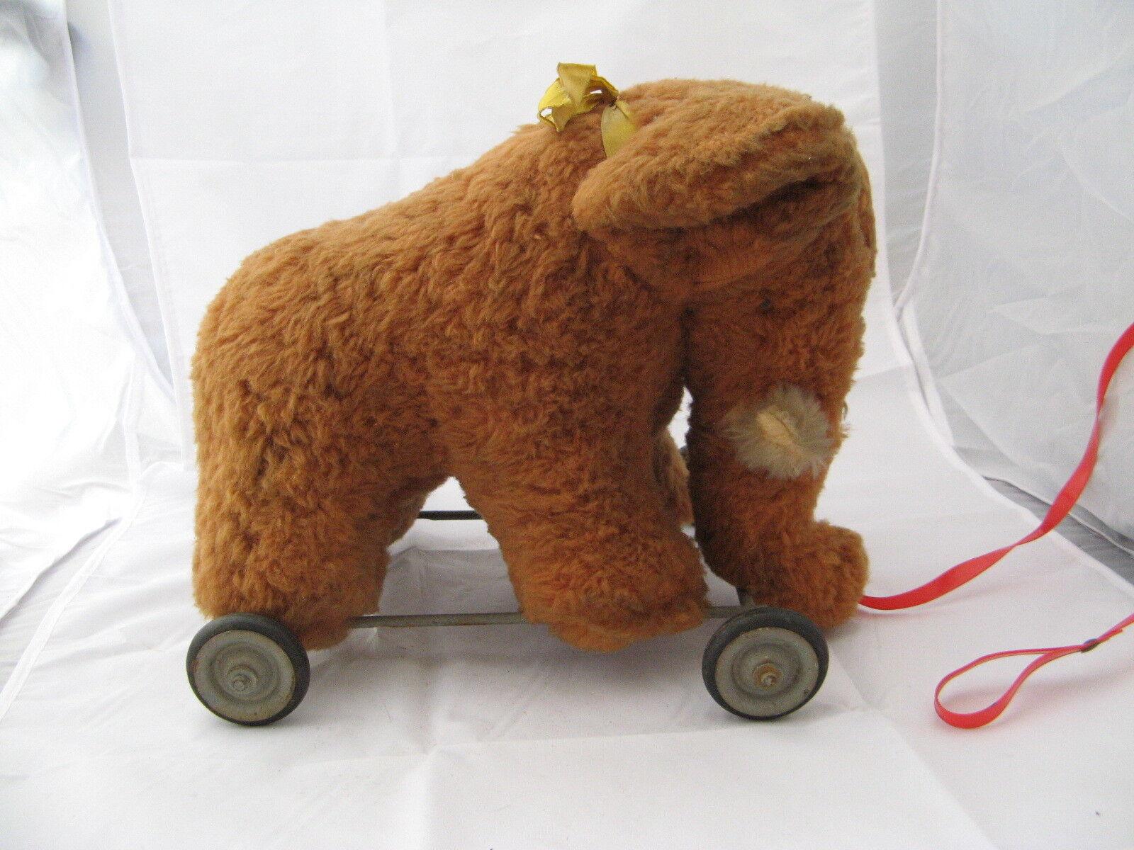 2307  pimo peluche éléphant sur roulette à tirer ancien