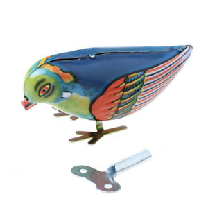 Wind-up-clockwork-pecking-song-blue-bird-magpie-tin-toy-vintage-retro-gifWYB