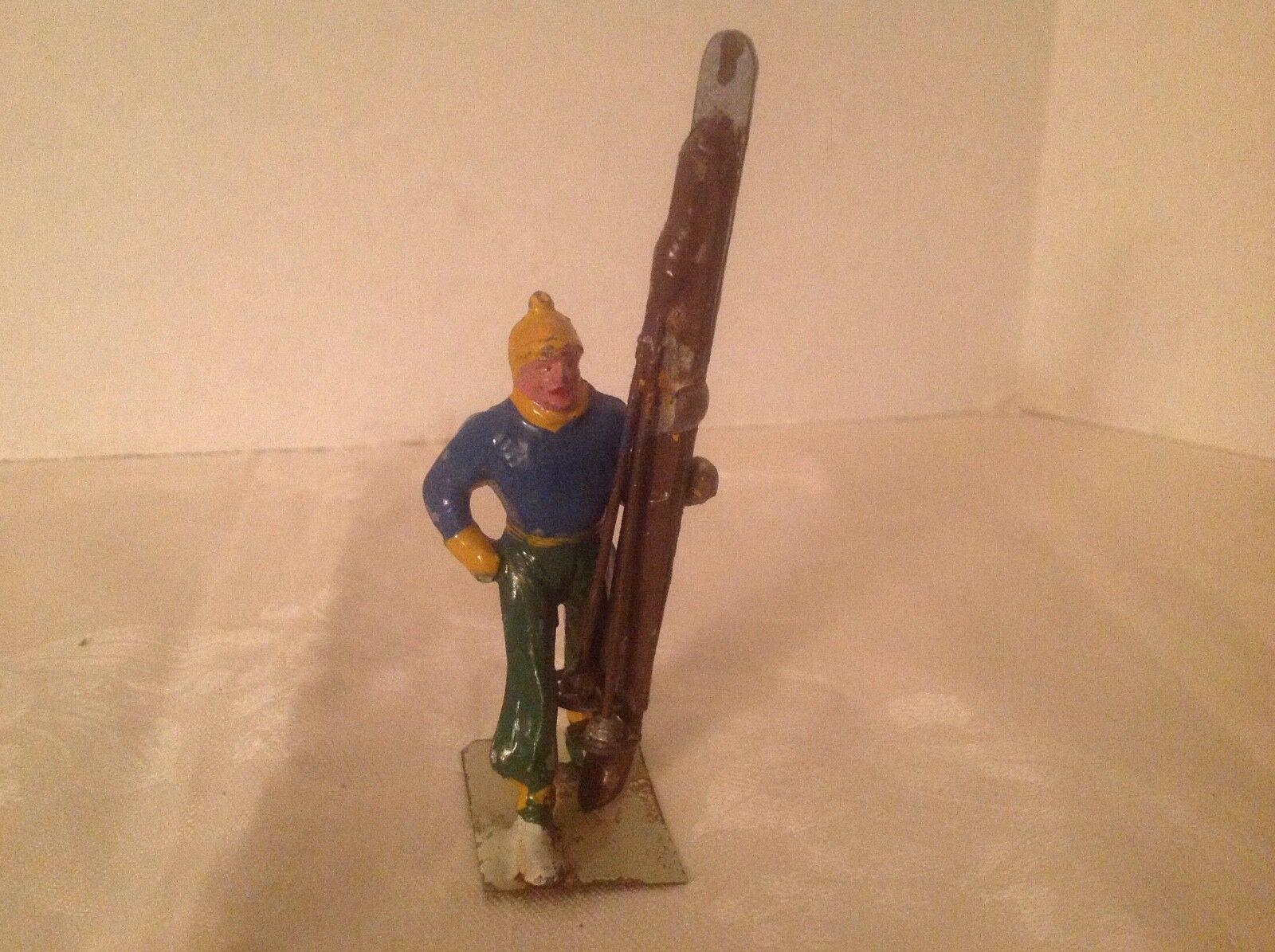 Vintage lead skier carrying skis upright France