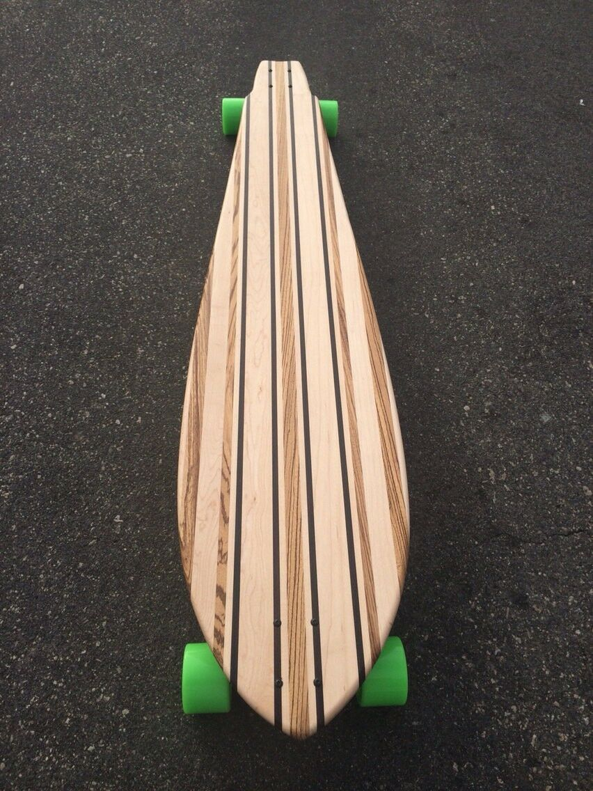Longboard made of Solid Wood- Arrowhead 55x12 made from  Zebrawood  at cheap