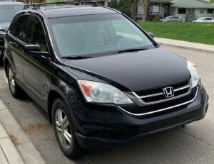 2010 Honda CRV Fully Loaded, 2 sets of tires on rims.