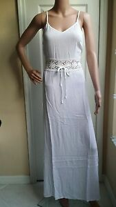 COUTURE COLLECTION, WHITE DRESS WITH STRAPS. GREAT FOR SUMMER!