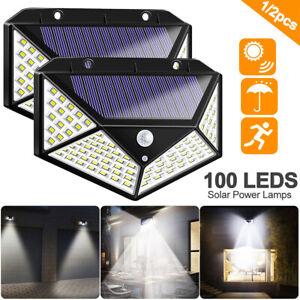 100-LED-Solar-PIR-Motion-Sensor-Wall-Light-Outdoor-Path-Yard-Security-Lamp