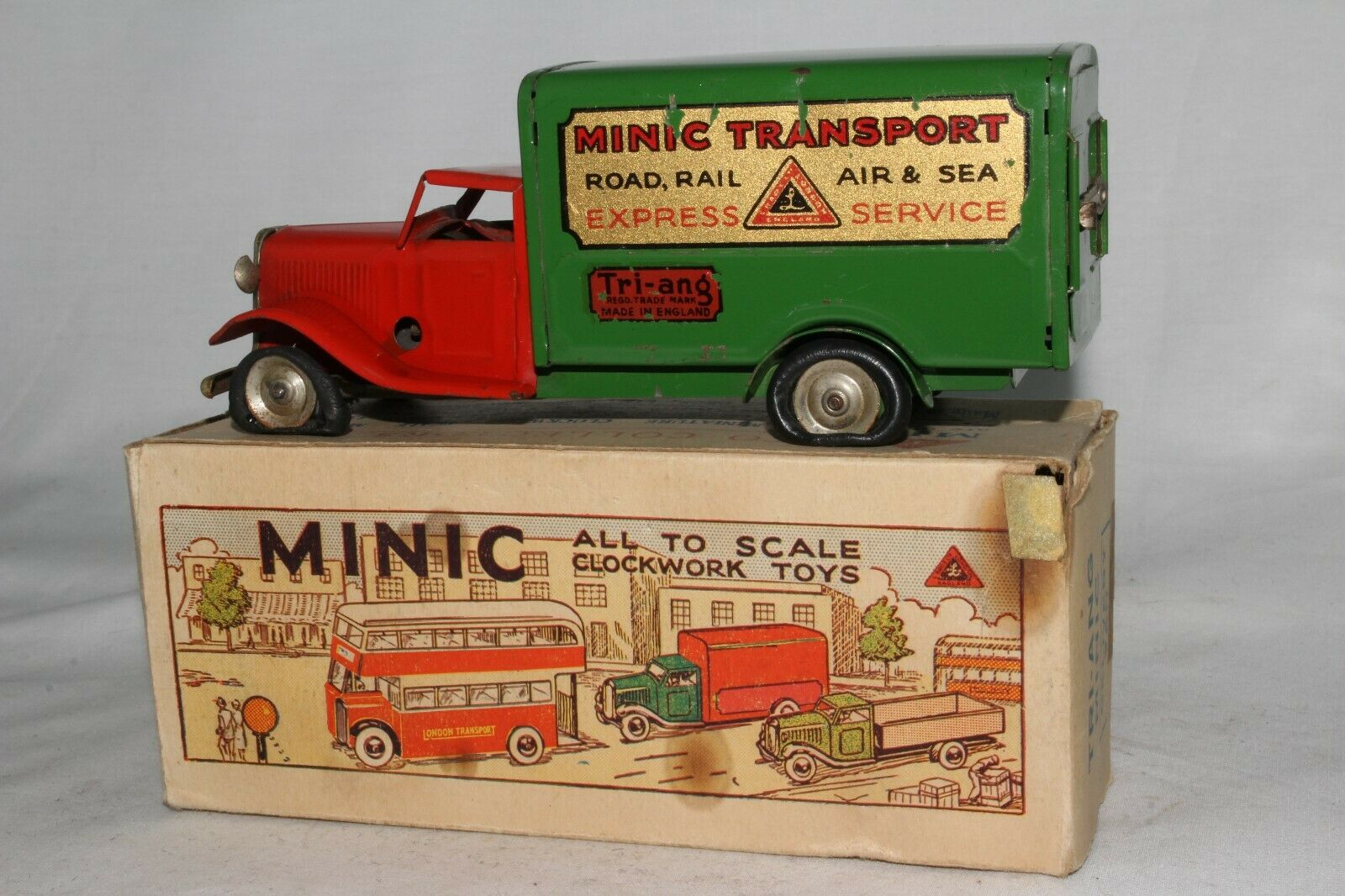 1980 s Triangminic Windup Tin Delivery Truck med originalruta