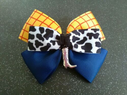Hand made hair bow//woody//jessie//toy story themed//bow clip