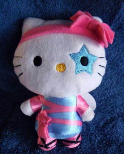1822a Hello Kitty doll with wings & blue star on one eye 15cm plush