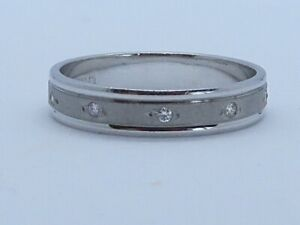 SIMPLY STUNNING DIAMOND BAND IN 18K GOLD SIZE N