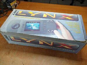 Atari Lynx with original box and 4 games
