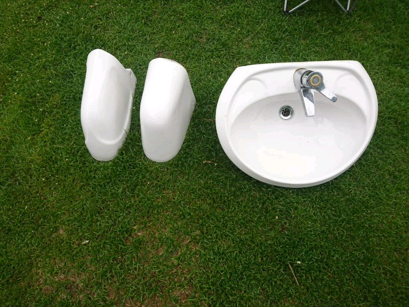 Hand basin with tap