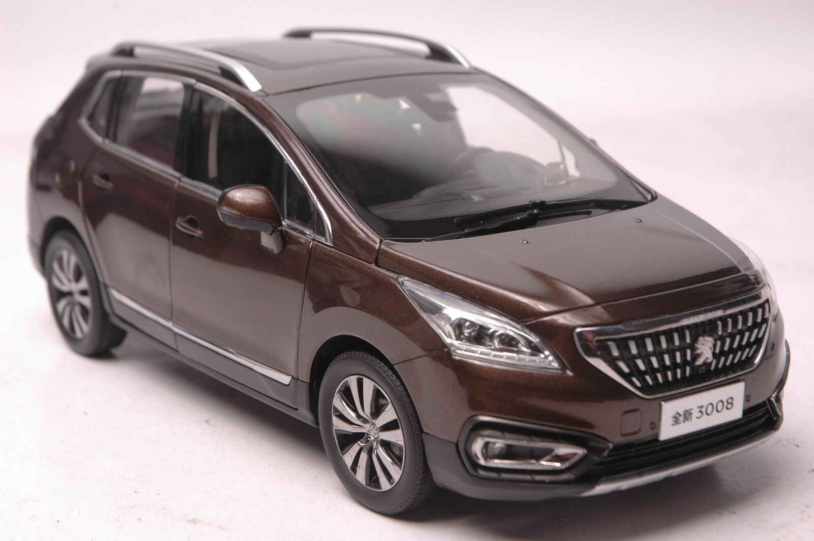 Peugeot 3008 2016 SUV model in scale 1 18 brown