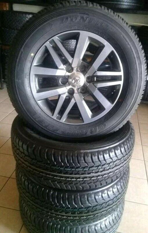 """18"""" Toyota Hilux/Fortuner mags with brand new 265/60/18 Dunlop Grandtrek A/T set R13799."""