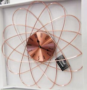 Curved Starburst Copper Finish Metal Wall Clock 85521