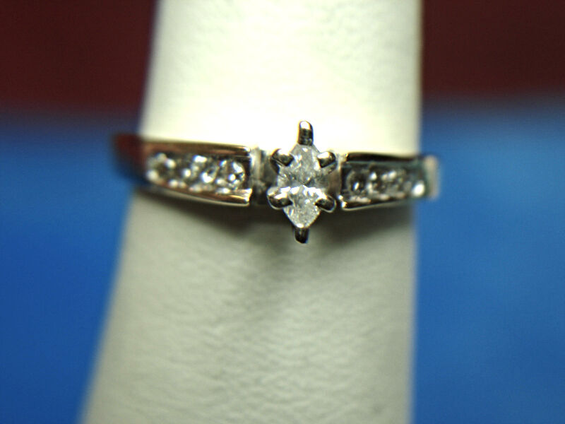 .25 CTW 10K YELLOW gold DIAMOND RING WITH MARQUISE & ROUND STONES - BRIGHT