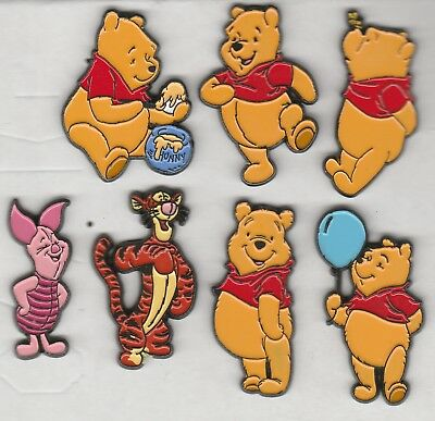 Nice collection of 7 Winnie the Pooh pins Tigger Rabbit