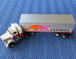 Faller-Aurora-AFX-Truck-With-Running-Light-2-New-Grinders-And-Tyre