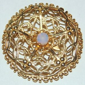Vintage-gold-tone-round-atomic-era-star-pentagram-glass-moonstone-pin-brooch