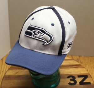 0fdb1b5bb55 Image is loading REEBOK-SEATTLE-SEAHAWKS-HAT-WHITE-BLUE-OSFM-EMBROIDERED-