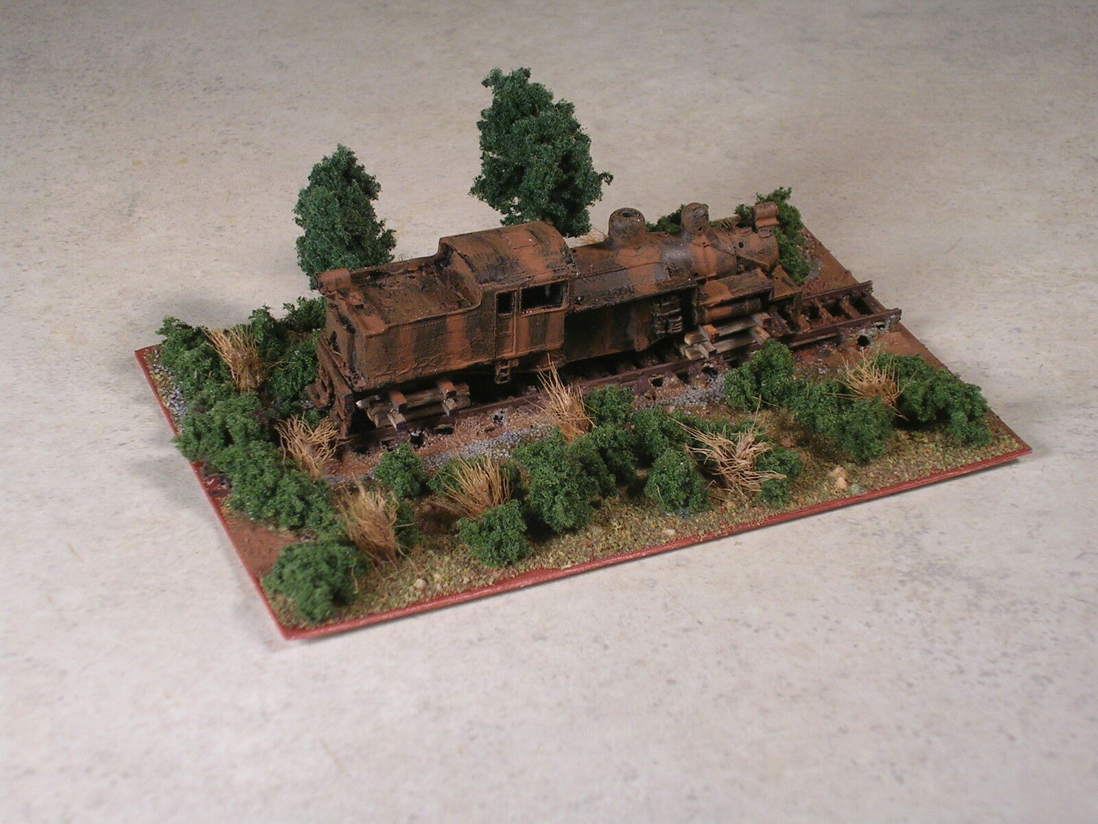 N Scale rusted out logging shay locomotive.up on ties diorama. Version