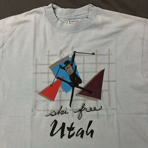 Vtg-Ski-Free-Utah-Shirt-Sz-Large-Light-Blue-Retro-Ski-Graphic-Short-Sleeve-Tee