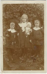 1908-Seriously-Strange-Children-with-Queen-of-All-Dolls-Real-Photo-Postcard