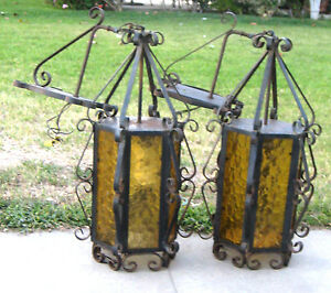 pair of wrought iron vintage outdoor gothic wall hanging lamps