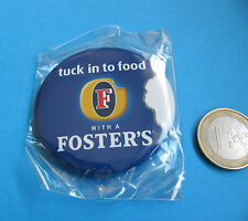 Fosters badge. Tuck in to food with Foster's. NIB