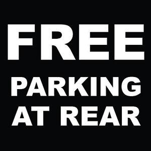 Free-Parking-At-Rear-Sign-8-034-x-8-034