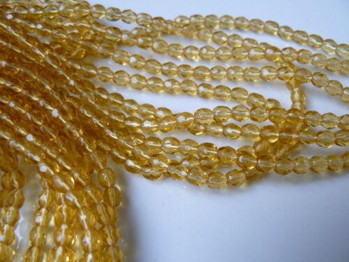 Lot de 50 perles à facettes 4mm jaune champagne