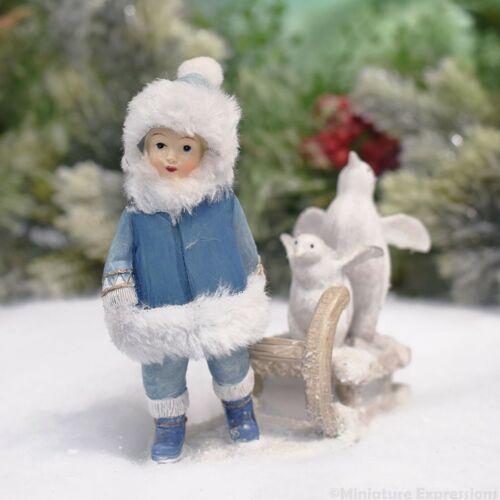 Kid with Penguins on Sled Christmas Figurine Tabletop Christmas Decoration