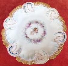 assiette porcelaine Limoges barbotine décor angelot