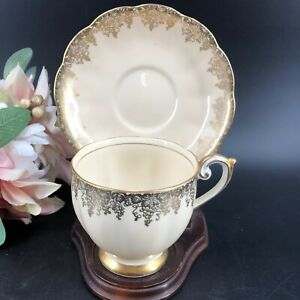 BELL-China-Teacup-amp-Saucer-4361-England-1930s-Gold-amp-Beige-Footed-amp-Wooden-Stand