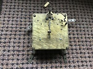 Foreign 2 train clock movement  13cm with pendulum  for spares or repair