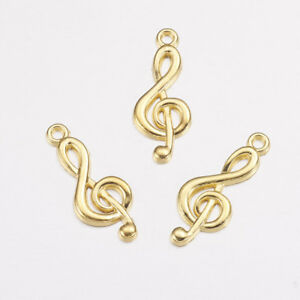 GC069 10 Musical Charms Antique Gold Tone Treble Clef