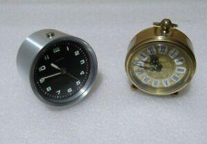 Lote-de-2-Relojes-sobremesa-alarma-carga-manual-Blessing-Mauthe-marchan