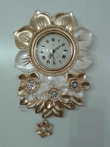 Orologio a pendolo da parete foglia oro swarovski via for Arredo parete salotto