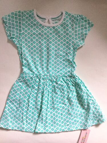 Baby//toddler Girl White Cotton Dress with Green Diamond shape detail.