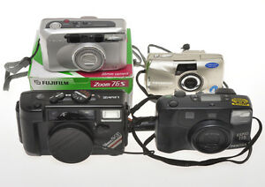 Lot-of-4-small-35mm-autofocus-cameras-Fuji-Nikon-Pentax-olympus-sold-as-is
