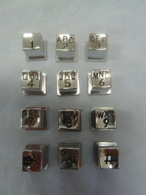 metal telephone keypad buttons with letters payphone prison phone