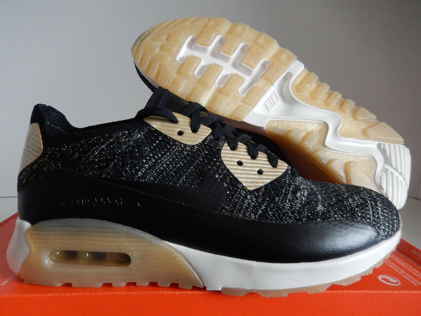 WMNS NIKE AIR MAX 90 ULTRA 2.0 FLYKNIT BLACK-GOLD Price reduction