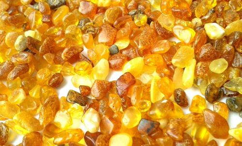 Small multi-colored pieces of natural Baltic amber in a scattering of 100 gr.