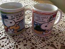 TWO PEANUTS SNOOPY COFFEE MUGS 2011