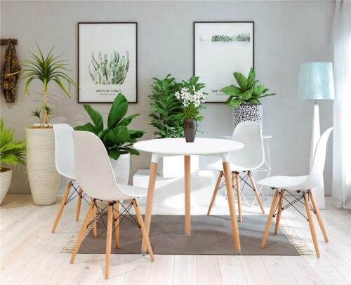 mesa redonda y cuatro sillas modernas