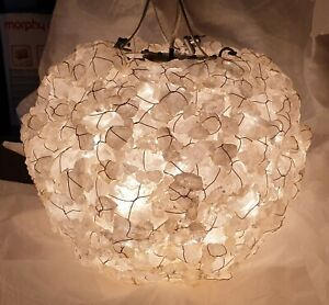 Round Rock Crystal chandelier. The natural beauty of quartz