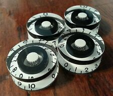4 Guitar speed volume / tone knobs.. Black / White. JAT CUSTOM GUITAR PARTS