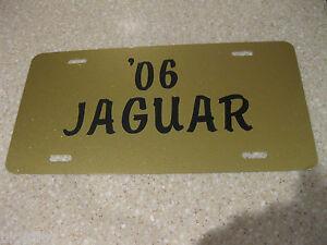 Details about JAGUAR GOLD GLITTER ALUMINUM LICENSE PLATE TAG ANY YEAR BLACK  VINYL LETTERING