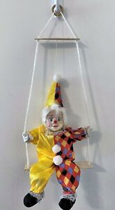 Vintage-Marionette-Porcelain-Faced-clown-on-swing-Yellow-and-Multicolored