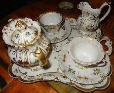 Service tête à tête à thé porcelaine de Paris de style rocaille début 19éme
