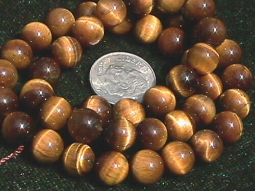A GRADE TEN BEADS 10 8mm Tiger Eye Round Beads
