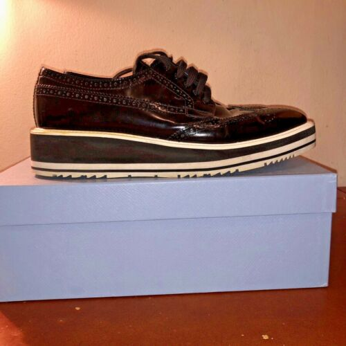 PRADA BLACK POLISHED LEATHER BROGUE WINGTIP CONTRA